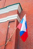 Russian state flag tricolor. Russian state flag tricolor on the facade of the Moscow Kremlin tower, a popular touristic landmark. UNESCO World Heritage Site stock images