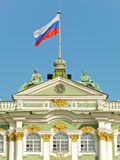 Russian state flag on Winter Palace Royalty Free Stock Photos