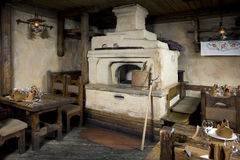 Russian stove. Interior of old russian home with traditional oven Stock Photo
