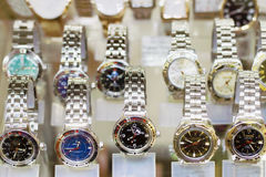 Russian stylish wristwatches. PERM, RUSSIA - AUG 18, 2014: Russian stylish wristwatches in showcase. Watch Factory Vostok produces popular wristwatch and was Stock Images
