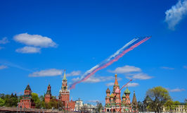 Russian Su-25 assault aircrafts leaving smoke as tricolor Russian flag at the rehearsal for the Victory Day military parade Royalty Free Stock Images