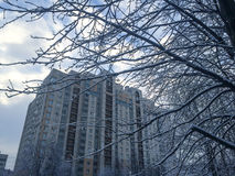 Russian suburb. View of a tall building in a Russian suburb in winter in St. Petersburg Stock Photos