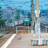 Russian suburban passenger train arriving to station. Russian suburban passenger train arriving to rural station Stock Photos