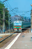 Russian suburban passenger train arriving to station. Russian suburban passenger train arriving to rural station Stock Images