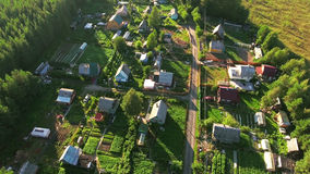 Russian summer village with wooden houses. Flying over roofs. Evergreen forests and marshes of northern Karelia, Russia Royalty Free Stock Image