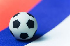 Russian symbol of football. Souvenir ball on the tricolor. Photo image sport background. Soccer championship 2018 in Russia on fla. Russian symbol of football Stock Photo