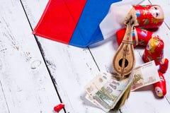 Russian symbols background. Russian symbols matryoshka, balalaika, rubles cash and flag of russian federation on wooden background Royalty Free Stock Image