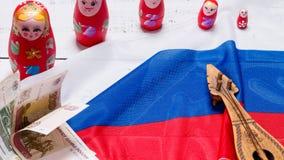 Russian symbols background. Russian symbols matryoshka, balalaika, rubles cash and flag of russian federation on wooden background Royalty Free Stock Photography