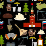 Russian symbols seamless pattern. Russia national ornament.. State traditional background. Moscow Kremlin and bear. Map of Russia and samovar. Earflaps and Royalty Free Stock Images