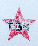 Russian T34 Soviet Star on Snow. Russian T34 Tank in black font symbol sign using a red Soviet Style star, dusted in fresh snowfall for use in military or Royalty Free Stock Photos