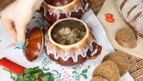 On the Russian table put a pot of food. Soup decorated with greenery. stock video footage