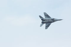 Russian tactical jet fighter MiG-29 in cloudy sky Stock Photos