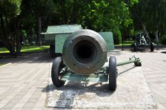 Russian tank and howitzer. Old weapons stock photography