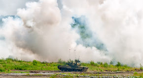 Russian tank T-80 making smoke screen from enemy Royalty Free Stock Photo