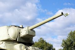 Russian tank with white roses in the gun Stock Photos