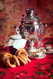 Russian tea. Traditional Russian tea from Samovar with cakes, bagels and raspberry jam Royalty Free Stock Photo