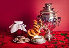 Russian tea. Traditional Russian tea from Samovar with cakes, bagels and raspberry jam Royalty Free Stock Image