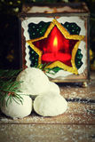 Russian tea balls cookies and festive candle Royalty Free Stock Images