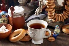 Russian Tea Party including black tea from samovar, lump sugar, bagels sushki and baranki. Traditional Russian Tea Party including hot black tea from samovar