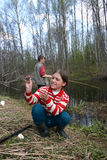 Russian teen girl caught small fish in a rural river. Royalty Free Stock Images