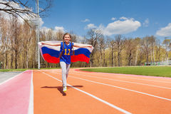 Russian teenage girl celebrating victory on track Royalty Free Stock Photo