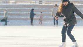 Russian teenager girl skillfully skating and spending time on public ice rink. Youth pastime and res stock video