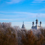 Russian temple in the frost forest Stock Photos