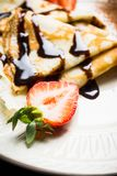 Russian thin pancakes blini, with strawberry and chocolate sauce. Selective focus stock images