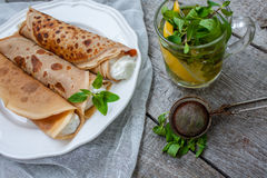 Russian thin pancakes with butter, cheese, jam, mint Royalty Free Stock Photography