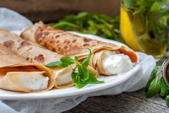 Russian thin pancakes with butter, cheese, jam, mint Royalty Free Stock Photo