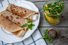 Russian thin pancakes with butter, cheese, jam, mint Stock Photo