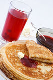 Russian thin pancakes with jam and butter Royalty Free Stock Photography