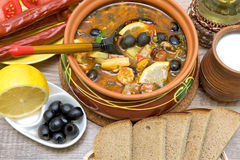 Russian thistle soup and other food on a wooden background Stock Photos