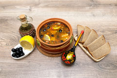 Russian thistle soup on wooden background. Royalty Free Stock Images