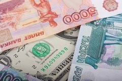 Russian Thousand Rubles and Dollar Bills Stock Photo