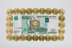 Russian thousandth banknote lined perimeter of a ten coins in the middle of the coin is a Royalty Free Stock Image