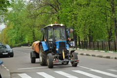 Russian tractor watering the streets Royalty Free Stock Photos