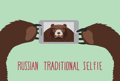 Russian tradition selfie. Bear takes pictures of herself. Stock Image