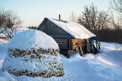 Russian traditional banya (banja) and stack of firewood. Royalty Free Stock Photo