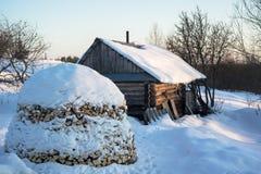 Russian traditional banya (banja) and stack of firewood. Royalty Free Stock Photo