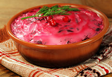 Russian traditional beetroot salad with fish herring Stock Photo