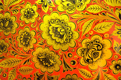 Russian traditional khokhloma pattern. Closeup of traditional russian decorative pattern called khokhloma. Golden floral design on red background Royalty Free Stock Photos
