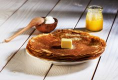 Pancakes with butter and honey Royalty Free Stock Images