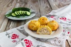 Russian traditional pies kurniki. Russian traditional pies kurniki on wooden background Stock Photos