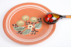 Russian traditional rustic ceramic plate and wooden spoon Royalty Free Stock Photo