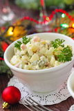 Russian traditional salad Olivier for New Year party Stock Photo