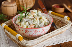 Russian traditional salad Olivier with vegetables and meat Stock Photos