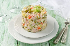 Russian traditional salad Olivier with vegetables and meat Stock Images