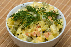 Russian traditional salad under the name Olivier Stock Photos