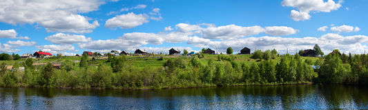 Russian traditional village on hill Stock Images